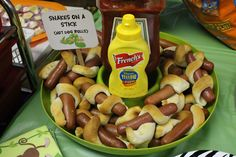 Indiana Jones Party Food: Snakes on a Stick Dogs, aka: Snakes. Why does it always have to be snakes.