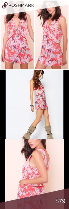 """Free People Santiago romper grapefruit Self & lining: rayon; trim: cotton V-neck and back, sleeveless, allover floral print, bow detail at bust Crochet inset trim and transverse back strap, two slit side pockets Lined, pull-on style 4"""" inseam, 32"""" leg opening Brand new with tag. Retail price $108. Smoke free and pet free home. Free People Pants Jumpsuits & Rompers"""