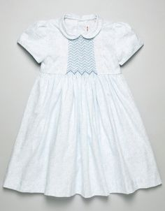 What a lovely smocked dress! Visit our website for adorable smocking plates, patterns, and fabrics!