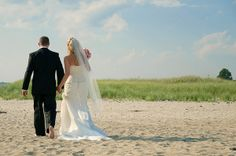 Bride & Groom walking on beach, Wells Maine. Photo by Rick Bouthiette Photography