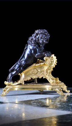 A pair of splendid gilt and dark patinated Bronze Chenets in the Louis XIV Palladian manner in the form of lions rampant standing on grand format sculpted, foliate plinths which in turn rest on similar under-plinths. Late 19th c.; 29 x 34 cm