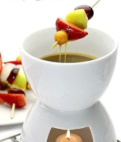 Slow cooker butterscotch fondue.Dipping fruit,berries,cake in this rum-laced confection is a completely luscious pleasure.
