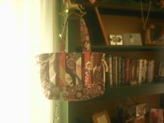 Quilted bag with open/close button ,1big pocket all Round inside bag 2small pockets  In front .17.5 wide.13 inch in length .$ 18
