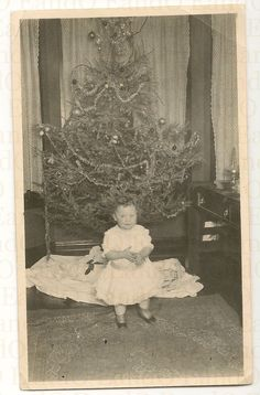 "Vintage Christmas Photo ~ Little girl in front of their lighted Christmas tree. The back is inscribed, ""Your second Christmas. Our first electric lighted Christmas tree - Lawndale Chicago."" ~ Circa early 1900's."