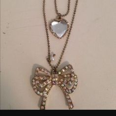 I just added this to my closet on Poshmark: 🎀🎀Betsey Johnson🎀🎀🎀Bow/Heart💝💝💝 Necklace. Price: $17 Size: OS