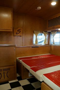 You'll find a full size bed in the front and twin bed in the rear of the trailer