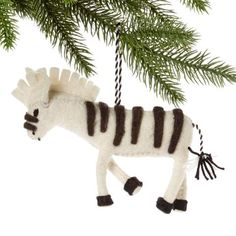 White Zebra Felt Holiday Ornament - Silk Road Bazaar (O) Women in Kyrgyzstan made this ornament by hand from felt. With a loop for hanging, the ornament measures 5 inches from nose to tail.