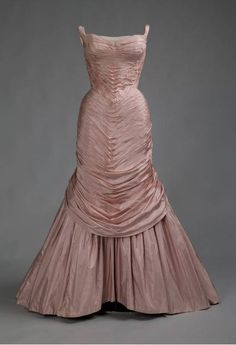 """""""Tree"""" Evening Dress, Charles James (1906-1978), New York: 1957, silk taffeta. """"James created his first Tree gown in 1955; this version followed two years later. He stated that the design used """"faille stretched like a ruched membrane over a stiffened shell molded NOT to the figure of the client, but to the shape I wished it were."""" He created numerous versions of this dress in various colors between 1955 and 1958..."""""""