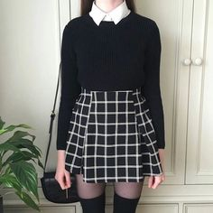 white collared shirt, black sweater, black & white grid skirt, knee high tights