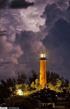 Lighthouse in lightning and storm, Jupiter Coast, Florida