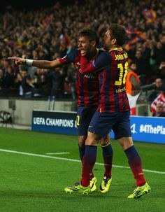 Neymar (L) of Barcelona celebrates his goal with Jordi Alba of Barcelona during the UEFA Champions League Quarter Final first leg match between FC Barcelona and Club Atletico de Madrid at Camp Nou on April 1, 2014 in Barcelona, Catalonia.