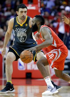 Houston Rockets guard James Harden (13) drives around Golden State Warriors center Zaza Pachulia (27) during the first half of an NBA basketball game Saturday, Jan. 20, 2018, in Houston. (AP Photo/Michael Wyke)