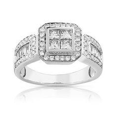 BAGUE en or blanc 750. 4 diamants taille princesse, 10 diamants taille baguette et 60 diamants taille brillant total 1 carat, qualité Tradition, environ 6 g.  Taille 50 à 62.