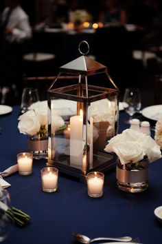 Lantern centerpiece, but add cotton and other rustic things. Cocktail hour though