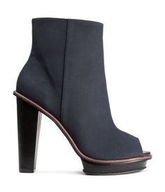 Peep-toe boots in imitation nubuck leather with side zip and rubber soles. Front platform height 3/4 in., heel height 4 3/4 in.