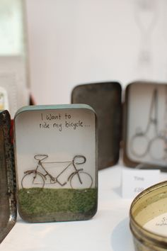 Louise Wilson - here she has created a mini scene in a tin then added a wire…