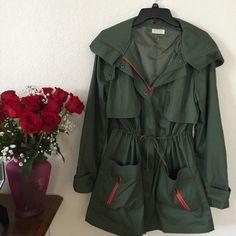 Green military Jacket Really nice jacket, you can wear it cinched at the waist or wear it straight. Working zippers on sleeves and back. Also snaps on the cuffs to adjust tightness. Necessary Clothing Jackets & Coats Utility Jackets