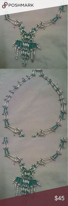 Safety Pin BOHO Necklace This is a handcrafted safety pin long glass beads (hard to see them, they cover the pin) and greenish seed bead BOHO necklace. It also has sterling silver plated beads. It took approximately 43 man-hours to make in July, 2016. During my cancer battle, I needed to work my hands due to the side effects of chemotherapy that caused extreme neuropathy (nerve damage). I've never worn it, and I'd love to find a loving home for it to admire and enjoy! Jewelry Necklaces