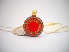 Round Red Sterling silver pendant necklace, Blue Gold dots concentric circles inlaid in hot Red polymer, Gold filled necklace by Hila Welner by hilawelner on Etsy https://www.etsy.com/listing/182024988/round-red-sterling-silver-pendant