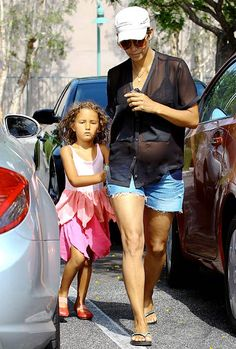 Halle Berry shows off her baby bump in a sheer top with daughter Nahla in Beverly Hills, California on June 9, 2013.