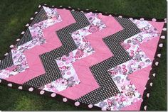 Image from http://craftystaci.files.wordpress.com/2012/08/chevron-baby-quilt-4_thumb.jpg?w=452&h=303.