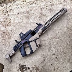 This is an amazing customized Kriss Vector submachine gun, though it looks a bit more like an assault rifle here, with its extended barrel, and guard.