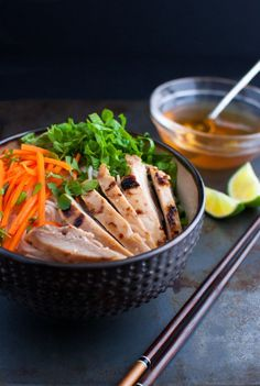 Vietnamese grilled chicken served with rice vermicelli noodles, fresh vegetables and herbs, and classic Vietnamese dipping sauce.