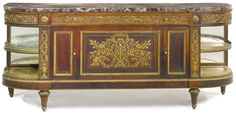 A carved giltwood decorated mahogany commodeà l'Anglaise<br>France, early 20th century, after the model by Guillaume Benneman | lot | Sotheby's