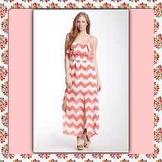 """Host Pick NWT Coral Ruffle Chevron Maxi Dress. New never used Want & Need Coral - Ivory Color Chevron Maxi Dress. Scoop neck. Strapless with adjustable spaghetti straps. Draped ruffle bodice. Elasticized waist. Sheer Coral chevron print overlay. Partly lined, Front slits. 57"""" Length. I have 2 left. 1 Med & 1 XLg. Want & Need Dresses Maxi"""