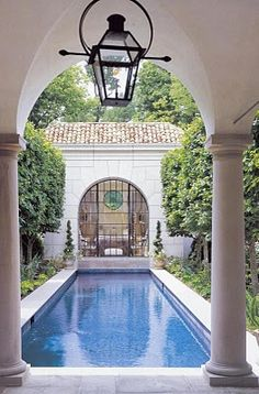 LOVE this lantern, pool, and pool house!