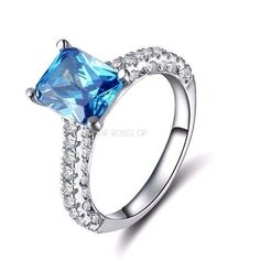 3 row crystal wedding ring with big ocean blue zircon cut surrounded... ($48) ❤ liked on Polyvore featuring jewelry, rings, wedding jewellery, cz rings, crystal wedding rings, cz jewelry and cz wedding rings #weddingrings