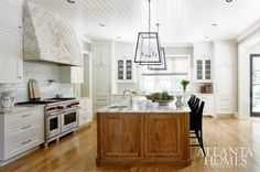 nice coloring, great range with double ovens, love the open feel, cool lanterns. Don't like the beadboard ceiling