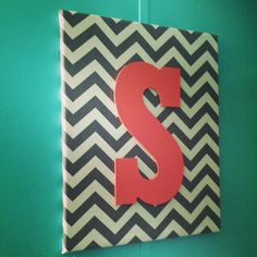 Fabric covered canvas with painted wooden initial. Coral and aqua bathroom!