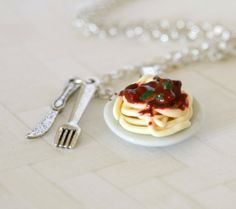 Pasta Bolognese necklace made from polymer clay plus tiny fork and knife. Plate is ceramic.  Each detail is made by hand and carefully placed.    Necklace