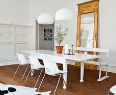 these old white chairs work really well with this white shabby chic wood table. Love the big shabby chic mirror.