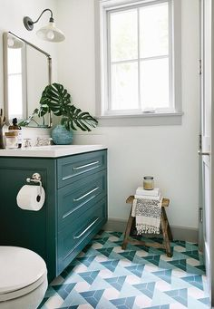 Peacock blue washstand with white countertop + triangle pattern floor tiles | Kate Lester Interiors