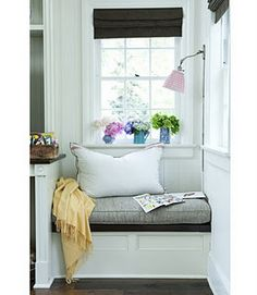 Some day I would love to have a little reading nook like this.