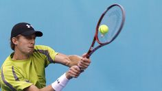 Kevin Anderson of South Africa returns the ball to Tomas Berdych of the Czech Republic during their men's singles match at the Madrid Open tennis tournament May 8, 2012.