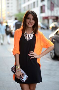 little black dress with a statement necklace and color pop sweater