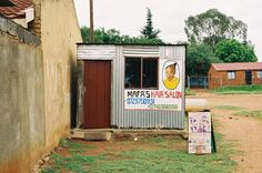 Simon Weller Photography: Marfa's Hair Salon, Klipspruit, Soweto Johannesburg, Artist: Smoky