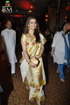 Nice to Aishwarya Rai wearing a saree draped in the traditional Bengali style!