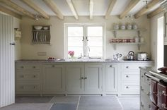 love the beams in this English country home kitchen by Landmark