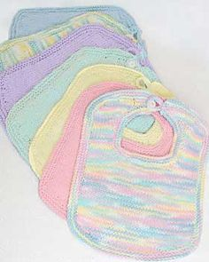 Easy-to-knit baby bibs are a great fun and practical project, perfect for gifts. Fits newborn to 6 mos. Shown in Bernat Handicrafter Cotton knit on size 4.5 mm (U.S. 7) needles.
