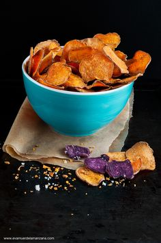 Slice sweet potatoes and boniato roots into thin rounds brush with olive oil and sprinkle with salt. Cook @ 200 degrees for 10-ish minutes. When golden and crisp remove from oven and sprinkle with cinnamon, nutmeg, and ginger. Let cool. Enjoy!