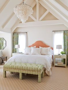 pitched ceiling, peach headboard, teal drapery
