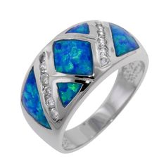 Exquisitely crafted blue Opals by Fire CZ complemented by 2 stunning lines of grade CZs inlaid in a Sterling Silver band Sterling Silver finished in Rhodium) Opal Band Ring, Blue Opal Ring, Blue Rings, Opal Rings, Blue Topaz, Silver Ring, Opal Jewelry, Copper Jewelry, Luxury Jewelry
