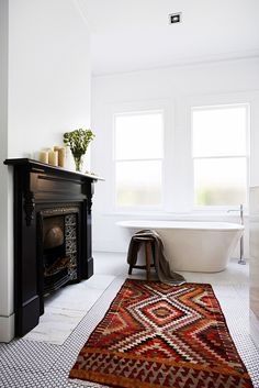 """Paula and Martin's dramatic timber home renovation:""""We decided to keep the bathroom fireplace,"""" says Paula. """"That saved on demolition and structure, and it's a great feature."""""""