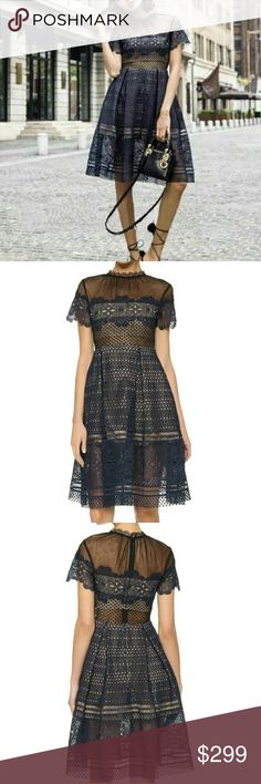 """Self-Portrait Felicia Lace Dress A contrast-mesh yoke brings a modern update to this feminine Self Portrait fit-and-flare dress. Box pleats sit below the waist. Short sleeves. Hidden back zip. Tan mesh lining. 40"""" total length. Brand new with tag. Navy color. Self-Portrait  Dresses Midi"""