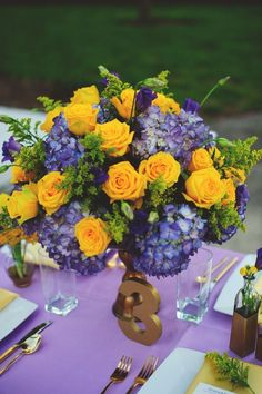 Elegant Lavender and Yellow Centerpiece // image by http://jasonmizephotography.com, florals by http://www.fhweddings.com, via http://theeverylastdetail.com/elegant-lavender-yellow-wedding-ideas/