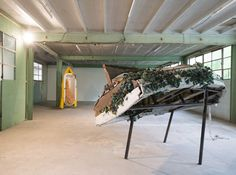Chen Zhen, Six Roots, Enfance | Childhood, 2000, bathtube, barbie, fabric, boat, toy soldiers, metal, bathtube: 215 x 55 x 80 cm about, boat: 173 x 382 x 150 cm about. Galleria Continua Les Moulins. Photo by Oak Taylor- Smith.